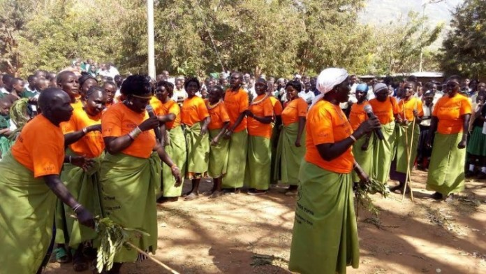 Former FGM specialists singing an anti-FGM song at a past function at Ortum Center. FILE PHOTO