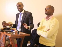 Sportpesa CEO Ronald Karauri (left) together with FKF president Nick Mwendwa