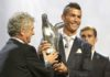 UEFA President Angel María Villar, left, gives the trophy for best player of the year to Real Madrid forward Cristiano Ronaldo