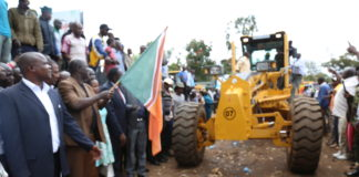 Governor Khaemba flags off the machines bought for road construction