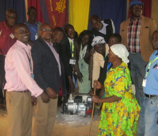 Joe Khaemba handing over the water pump to Kamusinde CBO