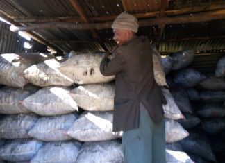 Mr. Nabuko in his charcoal store