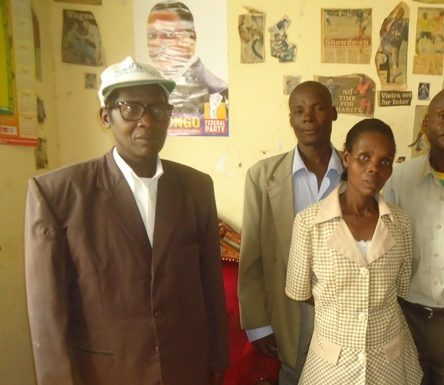 Mr. Simatwa Mwatia (L) with other officials at Mabuye Community Resource Centre, which offers adult education