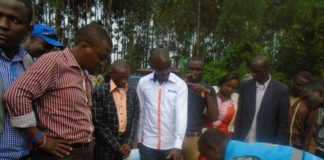Osumba Kajwang and Osele admiring a beehive exhibition project by Nucleus Childrens Trust Fund in Kakamega