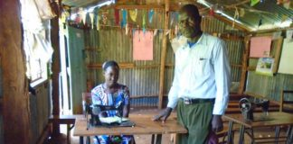 Wesonga and a student inside a workshop for practical lessons