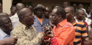 Governor Oparanya in confrontation with Mumias East MP Ben Washiali at Shibale market as Raila Odinga looks on