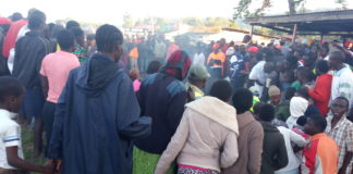 Residents look on as the suspect is lynched in Webuye