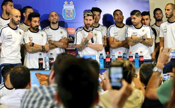 Argentina captain Lionel Messi accompanied by fellow teammates after their game against Colombia