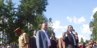 Deputy President William Ruto addresses residents in Nandi as President Kenyatta looks on