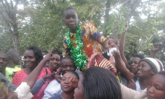 The top candidate Victor Oduor Odhiambo form Kakamega County hoisted by parents, and residents after the announcement of KCPE 2016 results