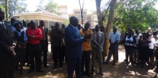 Vihiga Governor Moses Akaranga addressing nurses at the County headquarter offices
