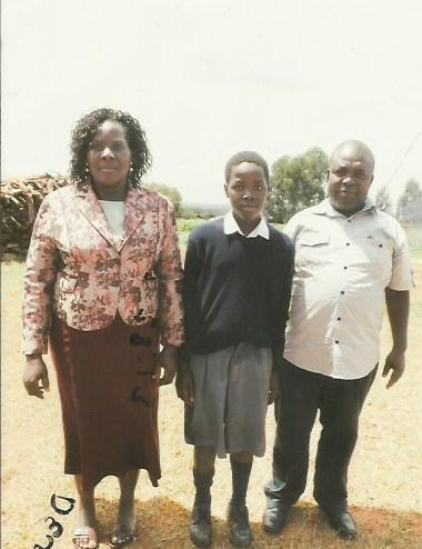 Prince Simiyu with his parents at school