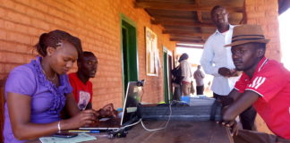 A resident being registered at Makutano Stadium registration centre