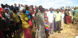 Bituyu residents at the scene of the incident