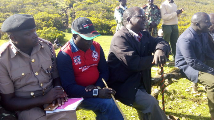 Deputy County Commissioner Eric Wamulevu(Left) and West Pokot Senator John Lonyangapuo in a peace meeting at Kamuligon area