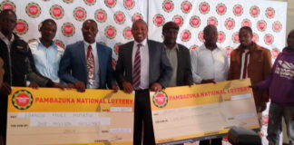 CEO Pambazuka National Lottery Mr. Paul Kinuthia (centre) with winners during awarding ceremony in Nairobi
