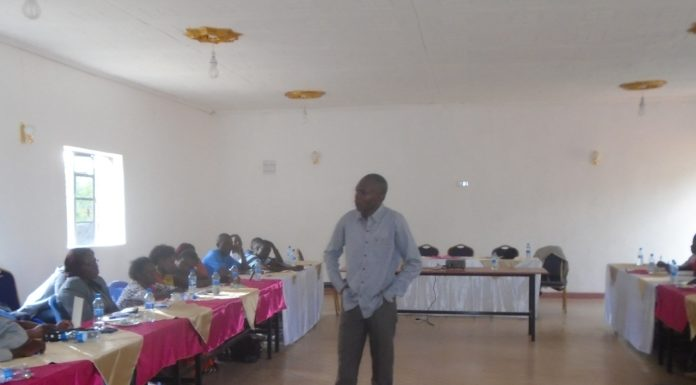 Kakamega county chief of staff Nabii Nabwera addressing participants during a one day civic education forum held at Downhill Resort
