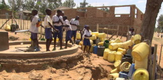 Pupils of Matibo RC Primary School in Sirisia surround the community water pump