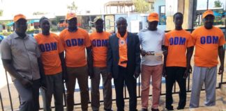 Busia County ODM youth league Chairman Eng James Anyango (middle) with sub county chairmen after a meeting in Busia