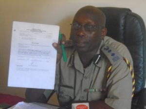 Likuyani OCPD Meshack Kiptum showing the Court eviction order