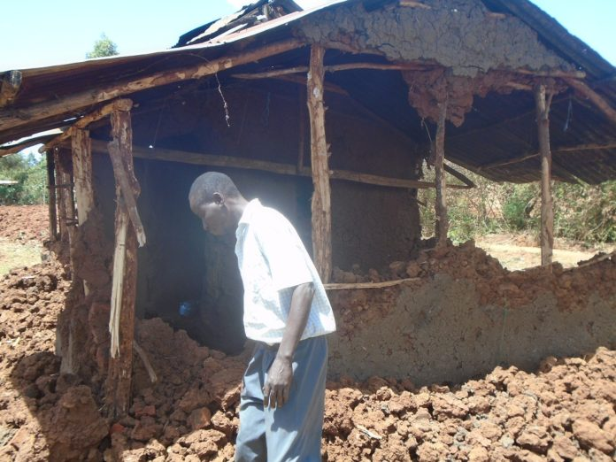Mr. Vincent Nyongesa outside his demolished house
