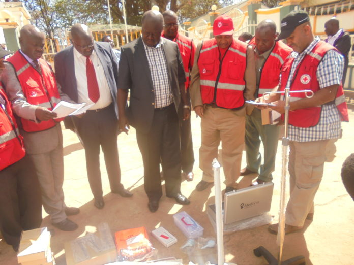 Trans Nzoia Governor Patrick Khaemba with Red Cross officials