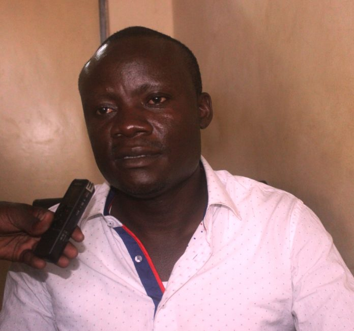 Busia County Youth League chairman Eng. James Anyango addressing the press in Busia