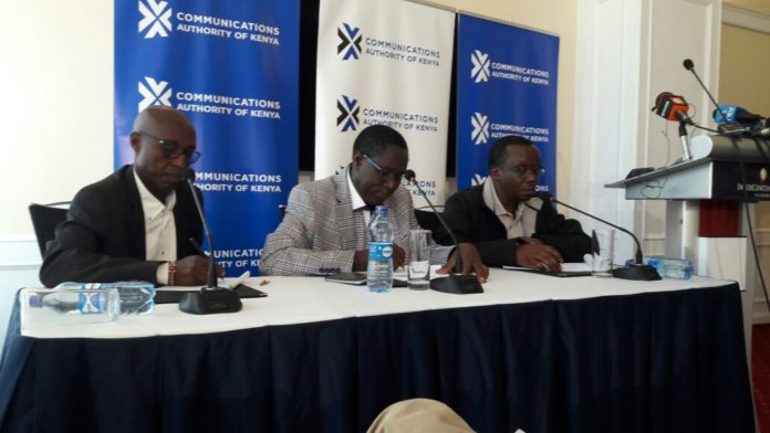 Communications Authority of Kenya Director General Francis Wangusi (centre) has insisted the Device Management System used by the Authority isn't a spying system