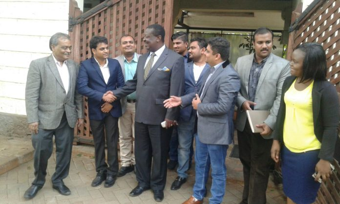 ANC Party Leader Musalia Mudavadi with a delegation of investors from Mumbai, India, outside his office