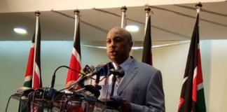 Government spokesman Eric Kiraithe addressing the press
