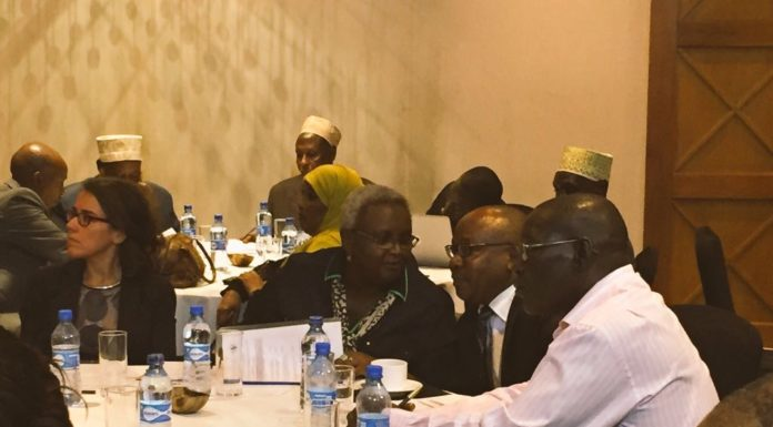 Kagwiria Mbogori, Chairperson for the Kenya National Commission on Human Rights (KNCHR) talking to Attorney General Githu Muigai at the meeting in Nairobi