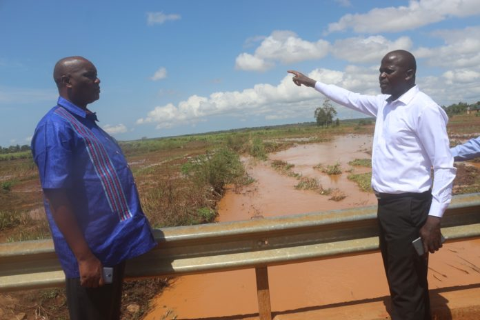 Busia Governor Sospeter Ojaamong and Nangina MCA John Obwogo inspect farms ravaged by floods