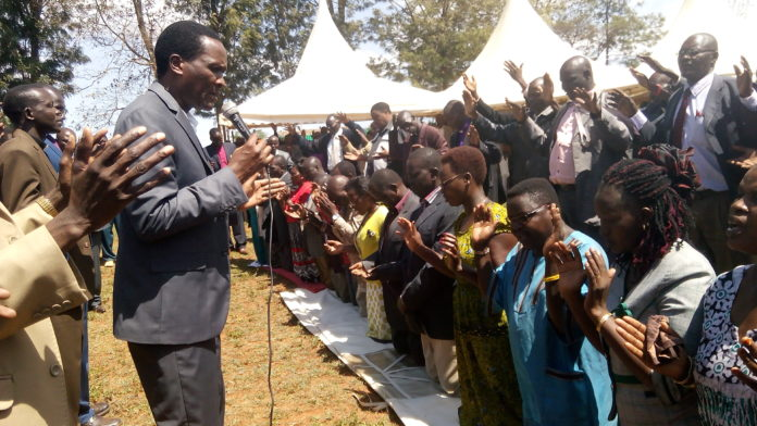 Deliverance church Pastor Tom Ngeywo leading the prayer meeting