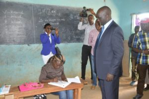 Governor Kachapin has his details checked during the Jubilee nominations exercise at Siyoi Primary school