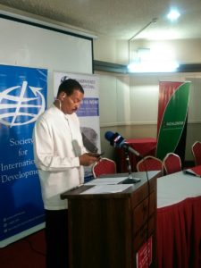 Society for International Development Associate Director Houghton Irungu addressing the press
