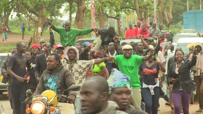 FORD Kenya Saboti MP aspirant Joseph Pepela (on the car and in a black jacket) celebrating his victory with supporters