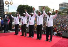 NASA leaders holding hands in a show of solidarity at Uhuru park