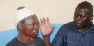 Nangina Ward MCA John Obwogo with Boniface Odenyo who is recovering from head injuries he sustained during a rally in Funyula