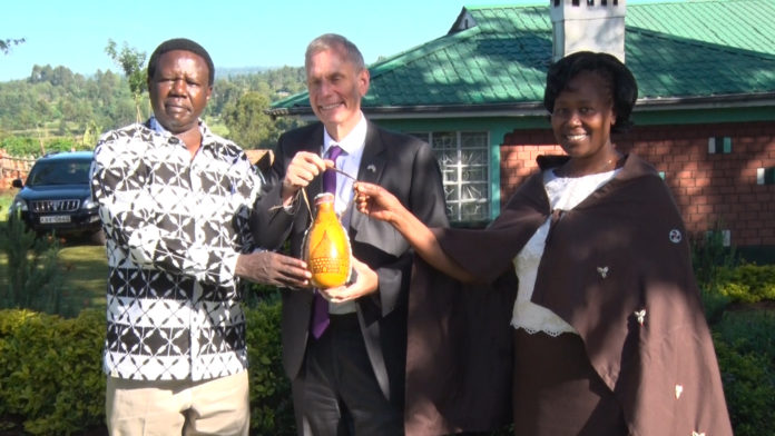 US Ambassador to Kenya Robert Godec (centre) at Savani in Nandi hills constituency where he had visited cottage industries and purple tea farms