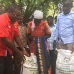 Bungoma Governor Ken Lusaka issuing fertilizer to farmers in the County