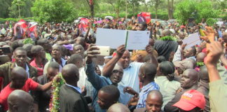 Kwanza MP aspirant Joshua Werunga celebrates with his supporters after being handed the certificate