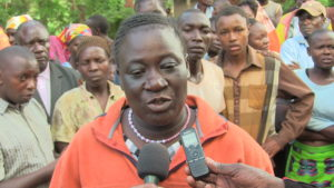 Evelyn Nabwoba Longino speaking to West Fm reporters at the scene of crime.