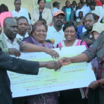 Trans Nzoia County MP Janet Nangabo gives out a cheque at the function