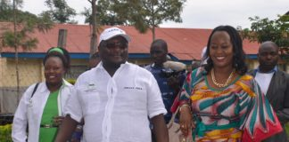 Vihiga Senator George Khaniri together with his wife after handing over his papers to IEBC officials at Chavakali Boys High School