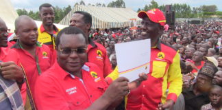 Bungoma Governor Ken Lusaka after receiving his certificate from Deputy President William Ruto