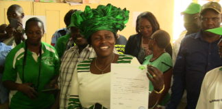 Catherine Wambilianga of Ford Kenya displaying her clearance certificate at the IEBC offices in Bungoma