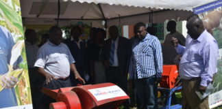 County Executive Member in the Ministry of Agriculture, Fisheries and Cooperatives Nixon Amendi (second right) being shown some of the machines at the exhibition where farmers benefited