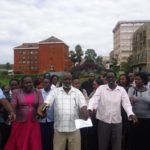 Nurses in Nandi, led by KNUN Nandi branch chairman Mr Paul Sang (holding a paper) have insisted the strike is still on