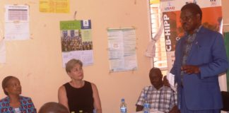 Busia CEC for health Dr Maurice Siminyu during the CB-HIPP meeting in Sio Portflanked byUSAIDHead of Health forthe Africa Bureau, Lisa Baldwin (2nd left)