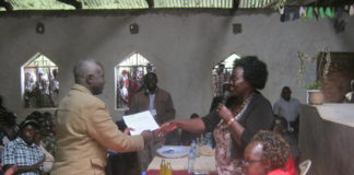 Dr. Reginalda Wanyonyi issuing Affirmative Action Fund bursary cheques in Tongaren constituency